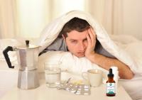 Miserable man with hangover and CBD Oil remedy